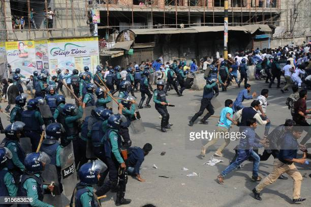 TOPSHOT Bangladesh police charge towards activists of the Bangladesh Nationalist Party protesting following a verdict against opposition leader...