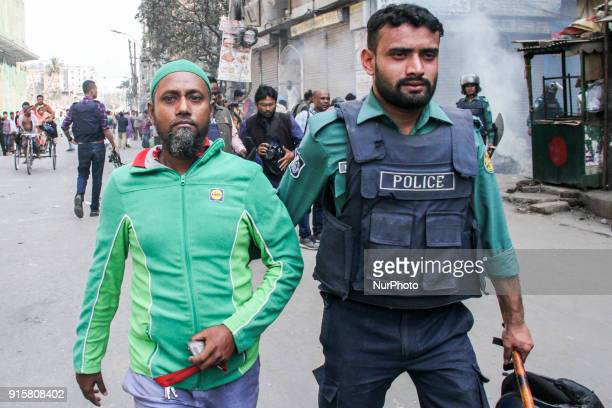 Bangladesh police charge towards activists of the Bangladesh Nationalist Party protesting following a verdict against opposition leader Khaleda Zia...