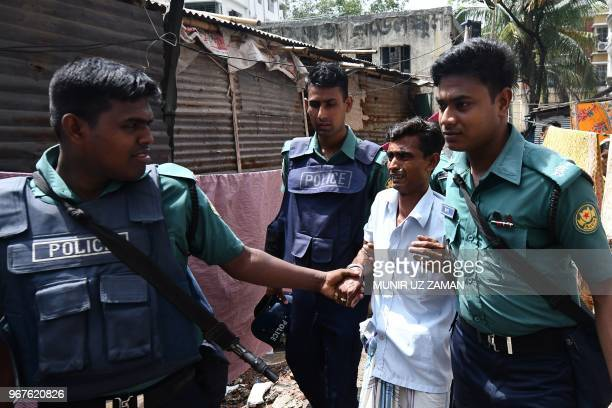 Bangladesh police detain a man during a drive against narcotics in Dhaka on June 5 2018 More than 100 alleged drug dealers have been killed and...