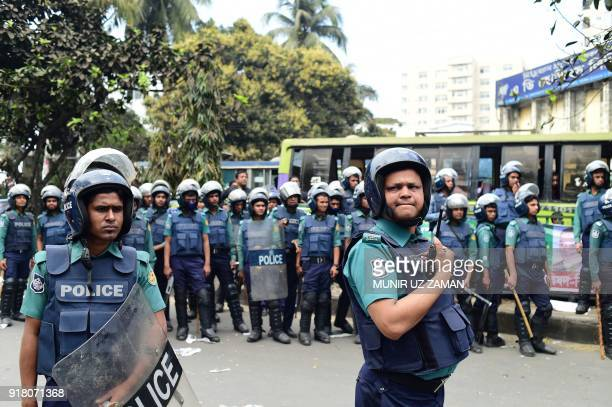 Bangladesh police stand guard as Bangladesh Nationalist Party leaders and supporters attend a protest and hunger strike against the verdict in a...