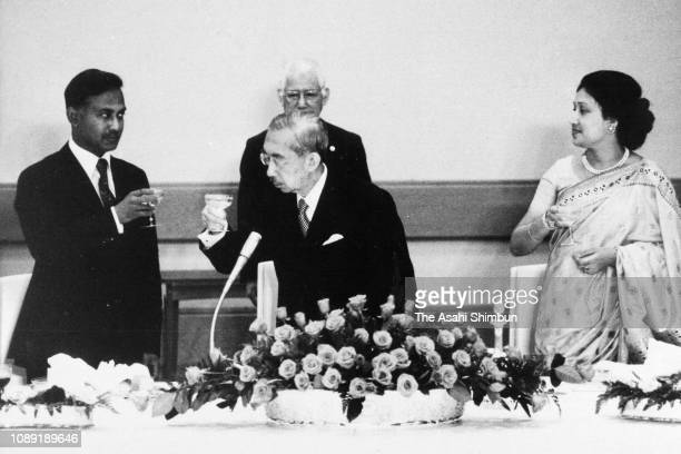 Bangladesh President Ziaur Rahman and his wife tKhaleda Zia toast glasses with Emperor Hirohito during the state dinner at the Imperial Palace on...