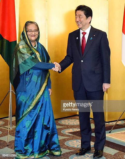 Bangladesh Prime Minister Sheikh Hasina and Japanese Prime Minister Shinzo Abe shake hands before their meeting in Nagoya central Japan on May 28...
