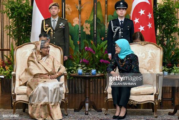 Bangladesh Prime Minister Sheikh Hasina chats with Singapore President Halimah Yacob during a call at the Istana presidential palace in Singapore on...