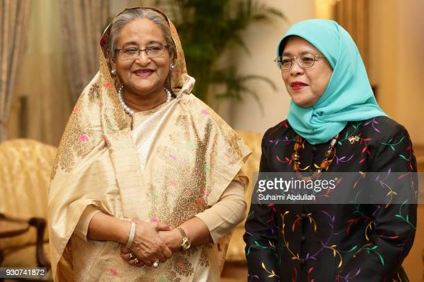 Bangladesh Prime Minister Sheikh Hasina meets with Singapore President Halimah Yacob at the Istana on March 12 2018 in Singapore Sheikh Hasina is on...