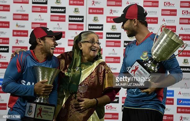Bangladesh Prime Minister Sheikh Hasina national test cricket captain Mushfiqur Rahim and national cricket captain Mashrafe Bin Mortaza pose for a...