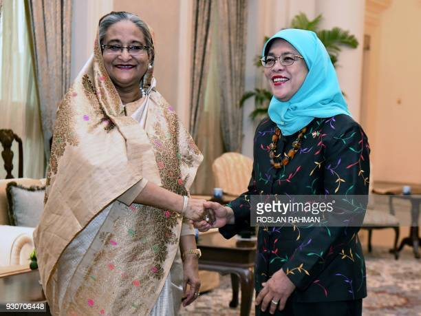 Bangladesh Prime Minister Sheikh Hasina shakes hands with Singapore President Halimah Yacob during a call at the Istana presidential palace in...