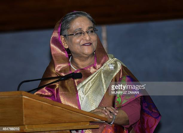 Bangladesh prime minister Sheikh Hasina speaks during a press conference at the Prime Minister's office in Dhaka on September 6 2014 Japanese premier...