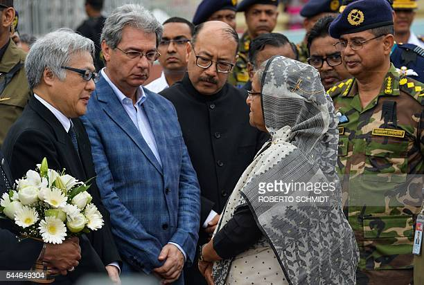Bangladesh Prime Minister Sheikh Hasina speaks to the ambassador in Bangladesh for Japan Masato Watanabe Italian ambassador Mario Palma and Indian...