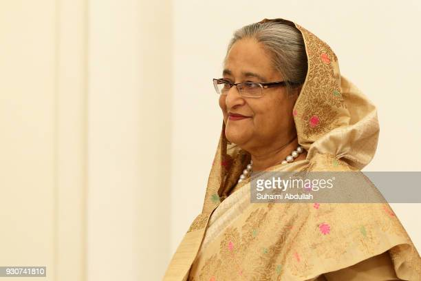 Bangladesh Prime Minister Sheikh Hasina takes her leave after witnessing the signing of the Memorandum of Understanding between Singapore and...