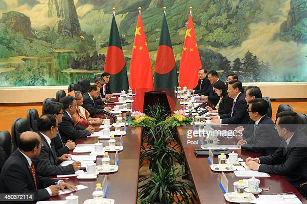 Bangladesh Prime Minister Sheikh Hasina talks with Chairman of the National Committee of the Chinese People's Political Consultative Conference Yu...