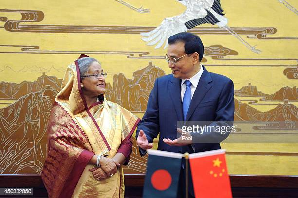 Bangladesh Prime Minister Sheikh Hasina talks with Chinese Premier Li Keqiang during a signing ceremony at the Great Hall of the People on June 9...