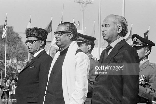 Bangladesh Prince Minister Sheik Mujibur Rahman stepping onto Pakistani soil for first time since the nation held him as a political prisoner listens...