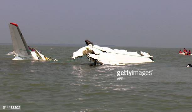 TOPSHOT Bangladesh rescuers gather around the wreckage of a cargo plane that crashed into the sea off Cox's Bazar on March 9 2016 A cargo plane has...