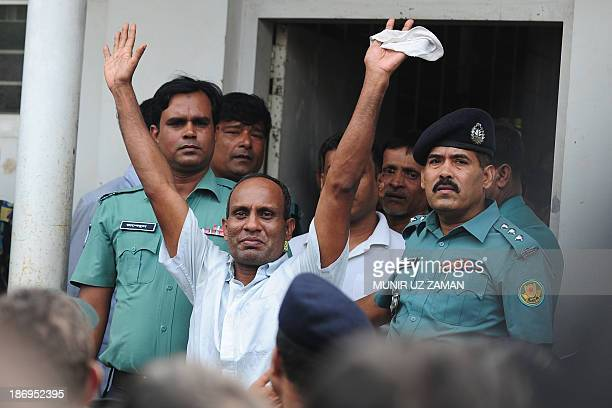 A Bangladesh Rifles soldier gestures following his acquittal at the special court in Dhaka on November 5 2013 A Bangladeshi court sentenced at least...