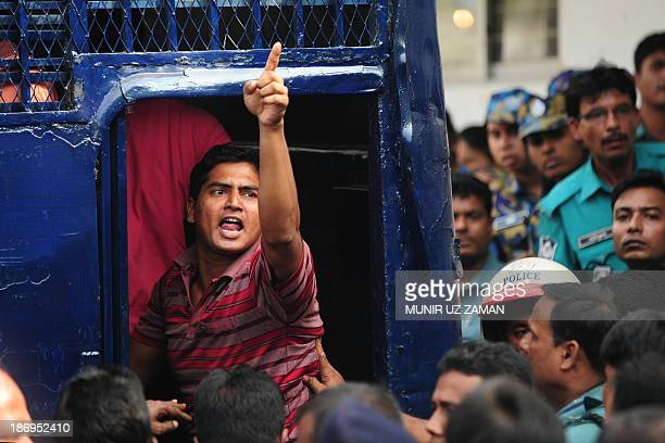 A Bangladesh Rifles soldier gestures following his sentencing at the special court in Dhaka on November 5 2013 A Bangladeshi court sentenced at least...