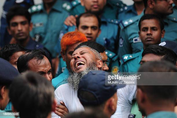 A Bangladesh Rifles soldier gestures following the announcement of his death penalty at the special court in Dhaka on November 5 2013 A Bangladeshi...