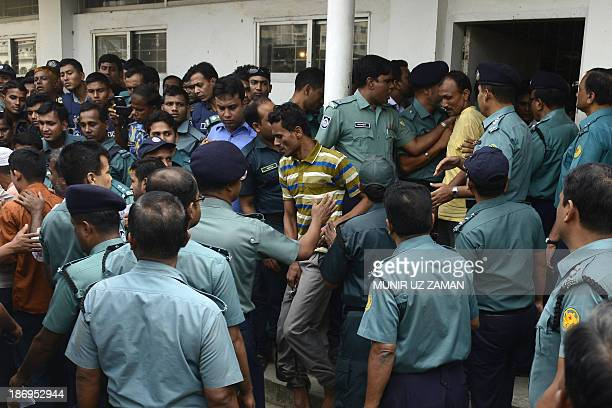 Bangladesh Rifles soldiers react as they leave the court premises following verdicts against them in Dhaka on November 5 2013 A Bangladeshi court...