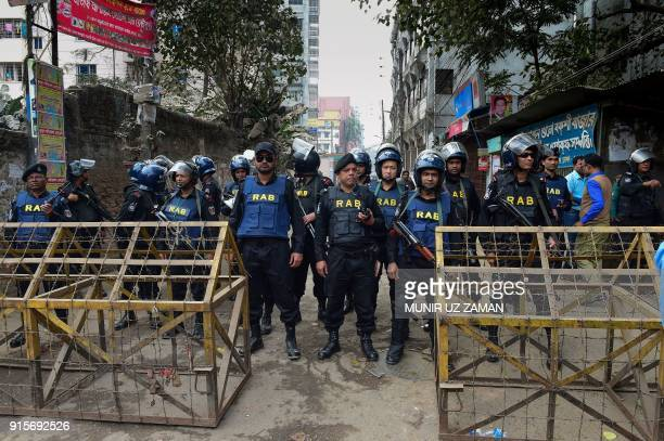 Bangladesh security personal stand guard at the entrance of the special court where a verdict in the corruption case of Bangladesh's main opposition...