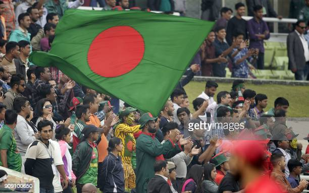 A Bangladesh spectator weaves a national flag during the fifth one day international match in the TriNations Series between Bangladesh and Zimbabwe...