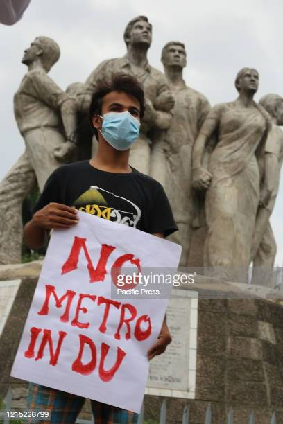 Bangladesh Student's Union members protest against the metro rail station standing near the Anti Terrorism Raju Memorial Sculpture at TSC at Dhaka...