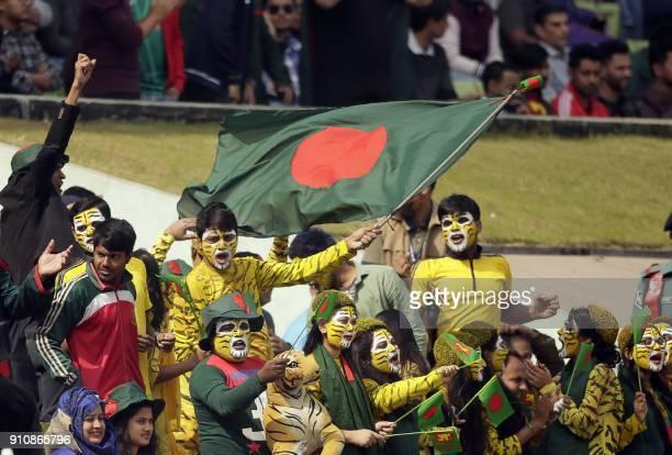 Bangladesh supporters celebrate after the dismissal of Sri Lankan batsman Danushka Gunathilaka during the final one day international cricket match...
