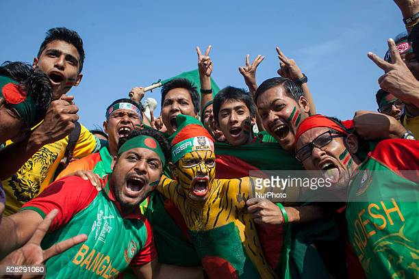 Bangladesh supporters celebrate on the streets of Dhaka after winning the 2015 ICC Cricket World Cup match against England and qualifying for the...