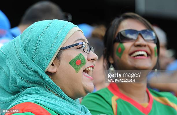 Bangladesh supporters cheer during the 2015 Cricket World Cup quarterfinal match between India and Bangladesh at the Melbourne Cricket Ground on...