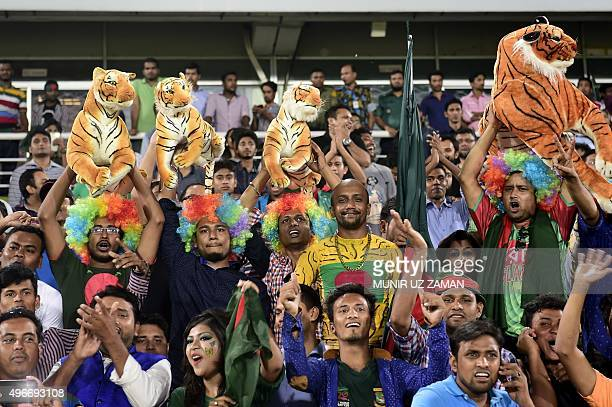 Bangladesh supporters cheer during the third oneday international cricket match between Bangladesh and Zimbabwe at the Shere Bangla National Stadium...