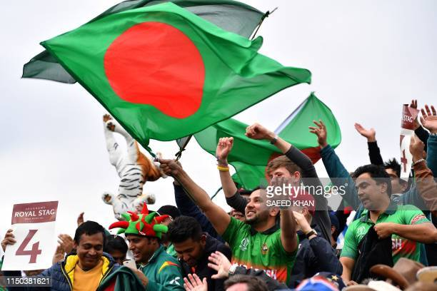 Bangladesh supporters wave their country's national flag during the 2019 Cricket World Cup group stage match between West Indies and Bangladesh at...