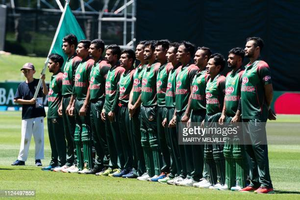 Bangladesh team players stand for the national anthems during the first oneday international cricket match between New Zealand and Bangladesh in...