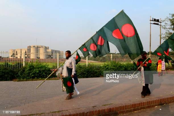 Bangladesh vendor sells national flag during Victory month in front of National Parliament in Dhaka Bangladesh on December 08 2019 Bangladesh won...