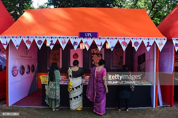 Bangladesh visitors browse books at a stall at the annual literature festival in Dhaka on November 17 2016 Top writers including 2001 Nobel laureate...