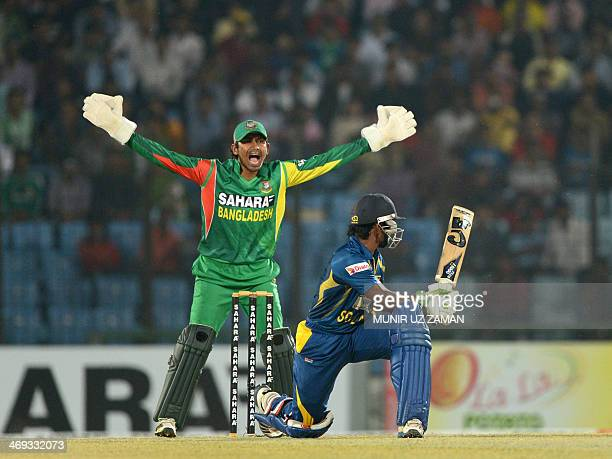 Bangladesh wicketkeeper Anamul Haque makes asuccessful appeal for the wicket of Sri Lankan batsman Kusal Perera during the second T20 cricket match...