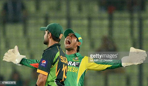 Bangladesh wicketkeeper Anamul Haque reacts after the dismissal of Pakistan batsman Ahmed Shehzad during the eighth match of the Asia Cup oneday...