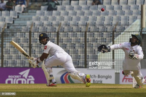 Bangladesh wicketkeeper Liton Das tries to take a catch to dismiss Sri Lanka cricket captain Dinesh Chandimal during the fourth day of the first...