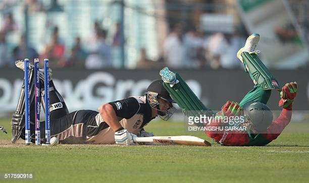 TOPSHOT Bangladesh wicketkeeper Mushfiqur Rahim falls as he attempts to run out New Zealand's Ross Taylor during the World T20 cricket tournament...