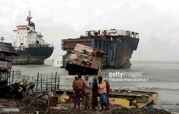 Bangladeshenvironmentshipping In this July 29 2008 photograph Bangladeshi labourers work in front of docked ships at a shipbreaking yard in Sitakundu...