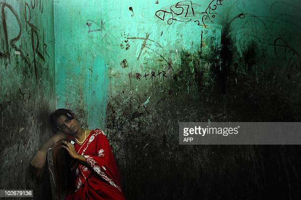 STORY 'BangladeshhealthprostitutionFEATURE' by Shafiq Alam A Bangladeshi sex worker sits in a governmentregistered brothel in Faridpur some 100...