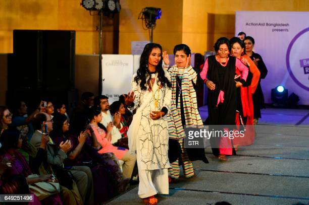 Bangladeshi acid attack survivors walk the runway during the fashion show Beauty Redefined by designer Bibi Russell in Dhaka on March 7 2017...