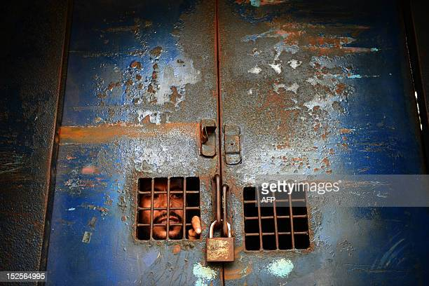 A Bangladeshi activist looks out from a prison van following his detention while taking part in a demonstration against the USmade antiIslam film...