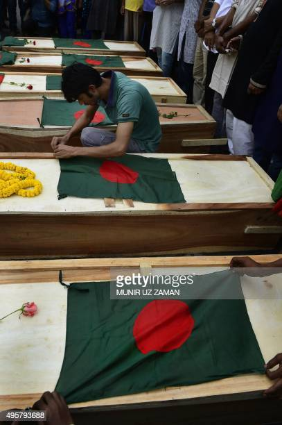 A Bangladeshi activist places a national flag on a mock coffin to symbolize the deaths of secular publishers and bloggers in Dhaka on November 5 2015...