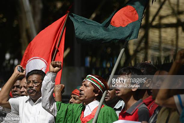 Bangladeshi activists and former freedom fighters who fought against Pakistan in the 1971 war shout slogans in celebration outside the International...