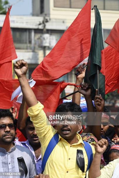 Bangladeshi activists and relatives of victims of the Rana Plaza building collapse take part in a protest to mark the sixth anniversary of the...