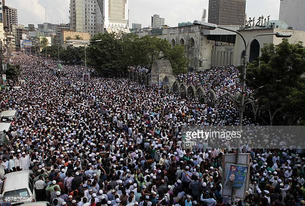 Bangladeshi activists and supporters of the JamaateIslami party gather outside the national mosque to offer prayers at the funeral of former party...