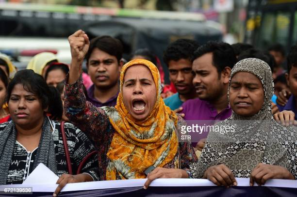 Bangladeshi activists chant slogans as they mark the fourth anniversary of the Rana Plaza building collapse at the site where the building once stood...