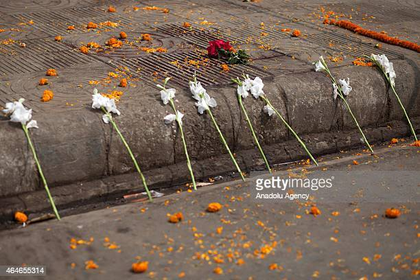 Bangladeshi activists put flowers on the place where prominent BangladeshiAmerican blogger Avijit Roy was hacked to death in Dhaka Bangladesh on...