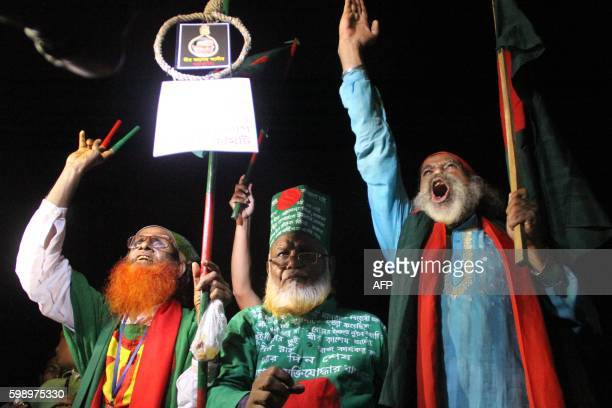 Bangladeshi activists who fought in the 1971 war celebrate after Mir Quasem Ali leader of the JamaateIslami party was executed in Kashimpur Central...