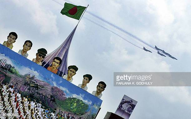 Bangladeshi Air Force pilots emit coloured smokes from their aircrafts during an acrobatic display as part of the Independence Day celebrations in...