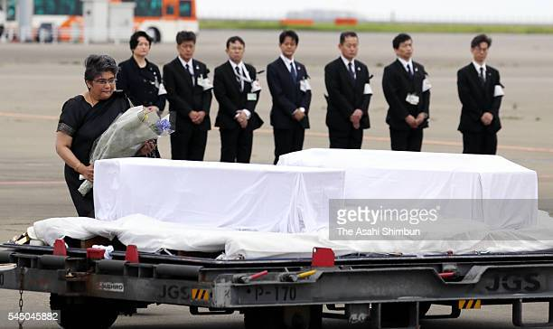 Bangladeshi Ambassador to Japan Rabab Fatima places flowers on a coffin of a Japanese victim of Dhaka terrorist attack at the Haneda Airport on July...