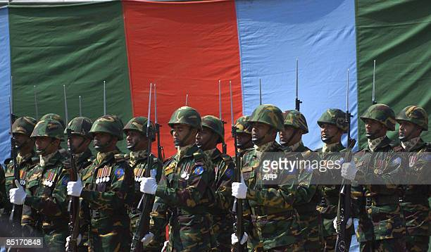 A Bangladeshi Army Guard of Honour performs ceremonial rites for military officers killed during a mutiny at a funeral ceremony in Dhaka on March 2...